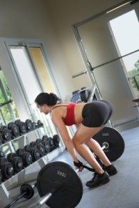 Fat Burning Diet - Woman lifting heavy weights