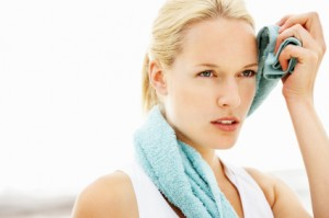 Fat Burning Diet - Woman Wiping sweat