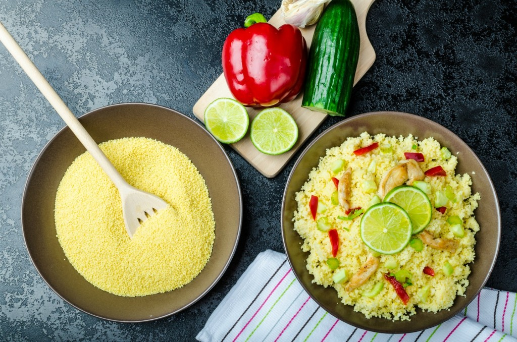 Couscous with grilled chicken meat and vegetables fresh lime on top